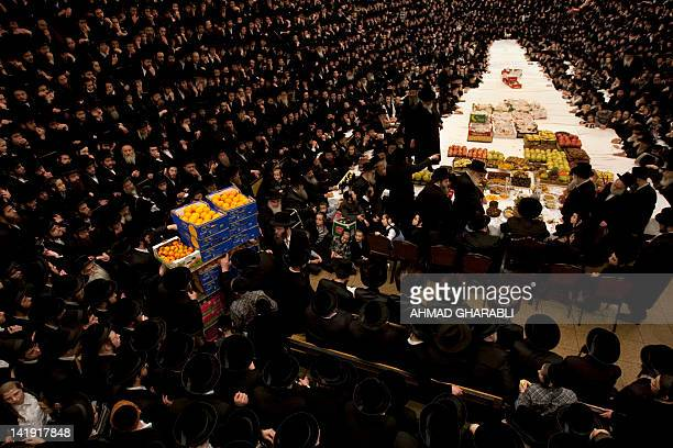 UltraOrthodox Jews of the Belz Hasidim celebrate the Jewish feast of Tu Bishvat the new year of the tree as they sit with their rabbis around a long...