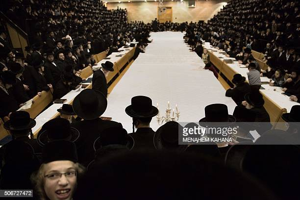 UltraOrthodox Jews of the Belz Hasidim take part in the celebration of the Jewish feast of Tu Bishvat on January 25 2016 in Jerusalem / AFP / MENAHEM...