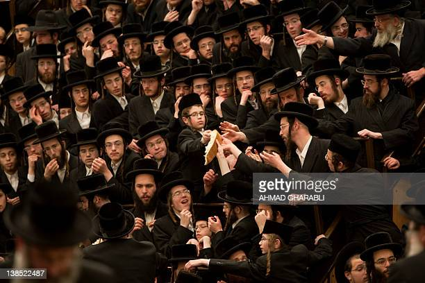 UltraOrthodox Jews of the Belz Hasidim take some breads during the Jewish feast of Tu Bishvat the new year of the tree in a ceremony in Jerusalem on...