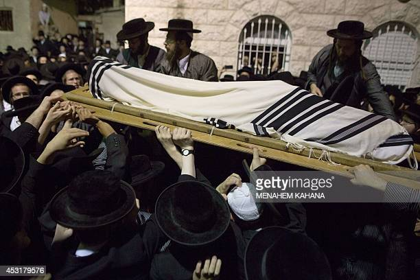 Ultraorthodox Jews of the Toldos Aharon an antiZionist Hasidic sect carries the body wrapped with a Talit of their member Avraham Wales during his...
