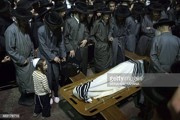 Ultraorthodox Jews of the Toldos Aharon an antiZionist Hasidic sect mourn next to the body of Avraham Wales wrapped with a Talit during his funeral...