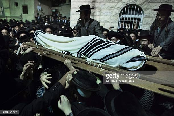 Ultraorthodox Jews of the Toldos Aharon an antiZionist Hasidic sect carry the body of Avraham Wales wrapped with a Talit during his funeral in the...