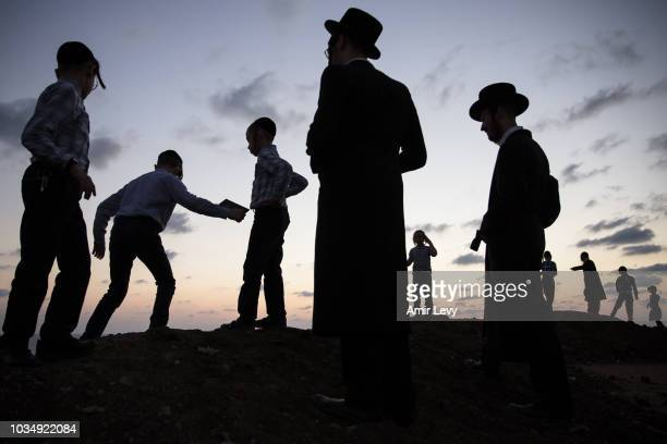 UltraOrthodox Jews of the Vizhnitz dynasty gather on a beach near the Mediterranean Sea as they practice Tashlich ceremony on September 17 2018 in...