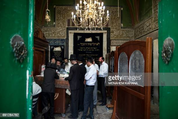 Ultraorthodox Jews pray at the Patriarchs' Tomb known in Arabic as the Ibrahimi Mosque in the the divided West Bank city of Hebron on May 29 2017...