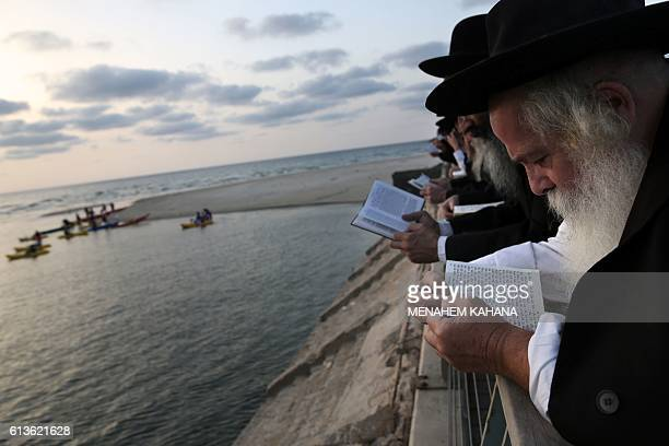 Ultraorthodox Jews pray in front of the Mediterranean Sea on October 9 2016 in the Israeli city of of Tel Aviv during the 'Tashlich' ritual Tashlich...