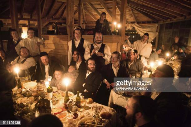 TOPSHOT Ultraorthodox Jews share a candle light diner to celebrate the Jewish ritual of 'Sheva Brachot' also known as the wedding blessings on...