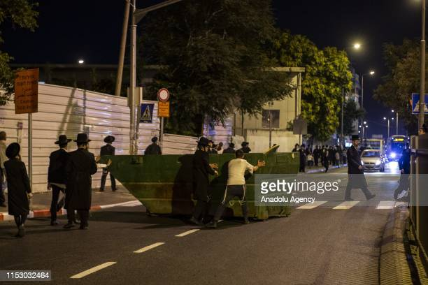 UltraOrthodox Jews stage a demonstration to protest detentions of 3 women who tried to deter Israeli youths to join the army in Jerusalem on June 30...