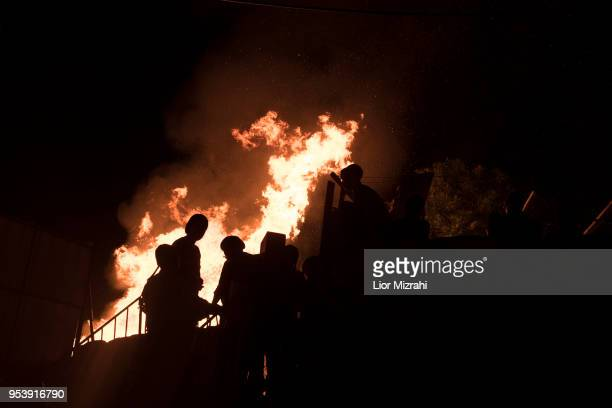 UltraOrthodox Jews stand next to a bonfire at Lag BaOmer celebration on May 2 2018 in Jerusalem Israel The Lag BaOmer bonfire is lit to commemorate...