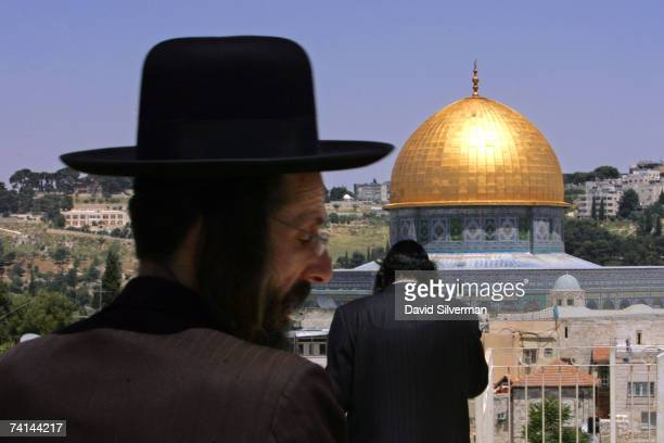 UltraOrthodox Jews stand on a rooftop looking out over the golden Dome of the Rock Islamic shrine May 14 2007 in Jerusalem's Old City Israel Israel...