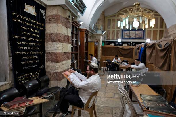 Ultraorthodox Jews study the Torah at the Patriarchs' Tomb known in Arabic as the Ibrahimi Mosque in the the divided West Bank city of Hebron on May...