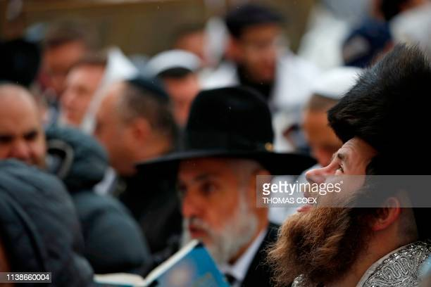 UltraOrthodox Jews take part in the Cohanim prayer during the Passover holiday at the Western Wall in the Old City of Jerusalem on April 22 2019...
