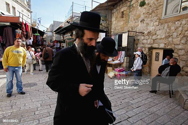 UltraOrthodox Jews walk along a section of the Via Dolorosa which passes through the Muslim Quarter of the Old City on February 10 2010 in Jerusalem...