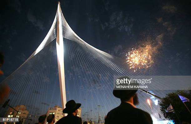 UltraOrthodox Jews watch fireworks during the inauguration ceremony of the 'Chords Bridge' designed by Spanish architect Santiago Calatrava at the...