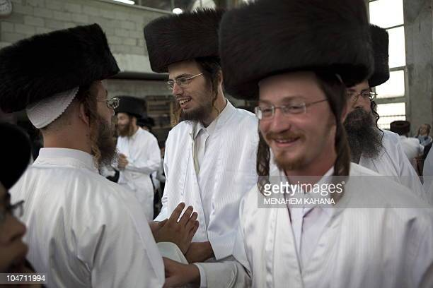 UltraOrthodox Jews wear white holiday cloths during noon prayers a few hours before the start of Yom Kippur the Jewish holy day of Atonement on...