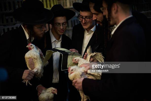 UltraOrthodox men perform the Kaparot ceremony on October 10 2016 in Jerusalem Israel It is believed that the Jewish ritual which involves swinging a...