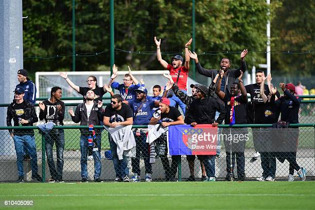 PSG Ultras group of supporters during the women's French D1 league match between PSG and Olympique de Marseille at Camp des Loges on September 25...