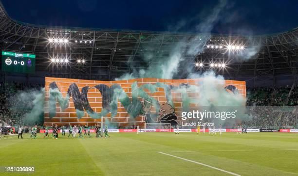 Ultras of Ferencvarosi TC hold a banner during the Hungarian OTP Bank Liga match between Ferencvarosi TC and Ujpest FC at Groupama Arena on June 20,...