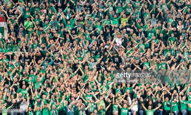 Ultras of Ferencvarosi TC rise theirs hands during the Hungarian OTP Bank Liga match between Ferencvarosi TC and Ujpest FC at Groupama Arena on June...