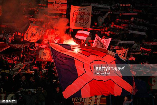 Ultras the hard core PSG fans wave their flags and flares during the French Ligue 1 match between Paris SaintGermain and Nancy at Parc des Princes in...