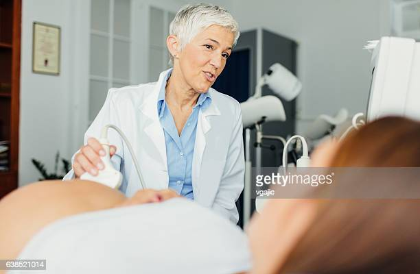 ultrasound examination in doctors office - pelvic exam stock photos and pictures
