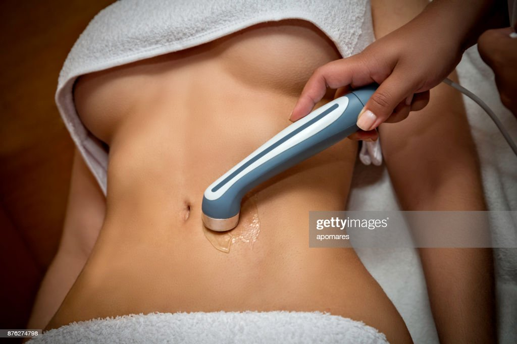Ultrasound treatment for fat reduction on abdomen : Stock Photo