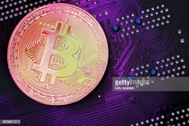 ultraviolet cryptocurrency bitcoin on mother board