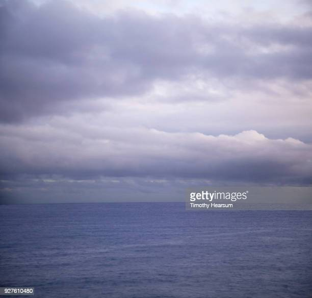 Ultraviolet sky and clouds creating a matching colored ocean