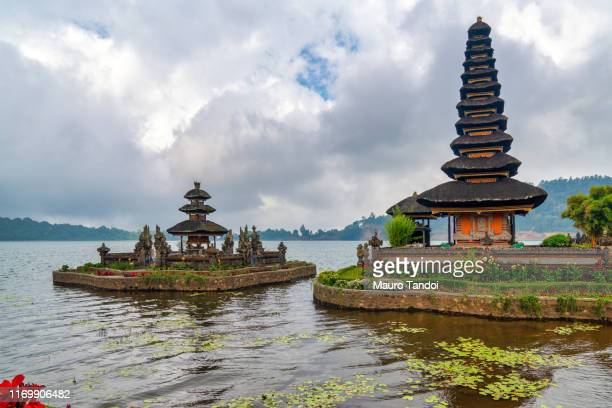 ulun danu beratan temple in bali, indonesia - mauro tandoi stock photos and pictures