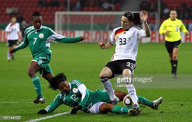 Ulunma Jerome of Nigeria challenges Verena Faisst of Germany during the women's international friendly match between Germnay and Nigeria at BayArena...