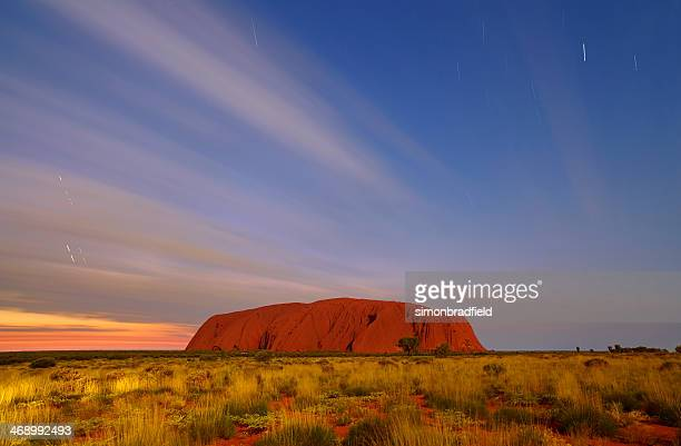 uluru by moonlight - uluru stock photos and pictures