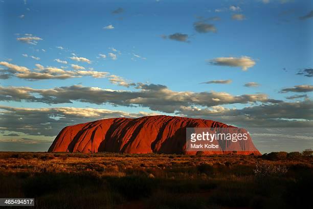 Uluru is seen at as the sun sets on November 27, 2013 in Uluru-Kata Tjuta National Park, Australia. Uluru/ Ayers Rock is a large sandstone formation...