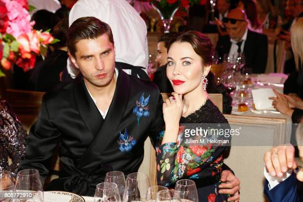 Ulyana Sergeenko and Guest attends the amfAR Paris Dinner 2017 at Le Petit Palais on July 2 2017 in Paris France