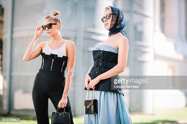 Ulyana Sergeenko and Lena Perminova are seen outside the Giambattista Valli show during Paris Fashion Week Spring Summer 2017 at the Grand Palais on...