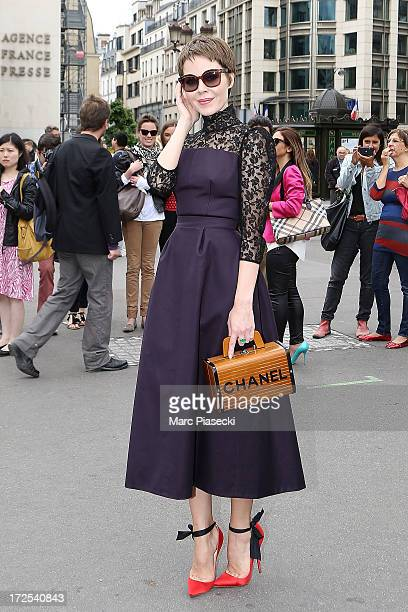 Ulyana Sergeenko attends the Elie Saab show as part of Paris Fashion Week Haute-Couture Fall/Winter 2013-2014 at Palais Brongniart on July 3, 2013 in...