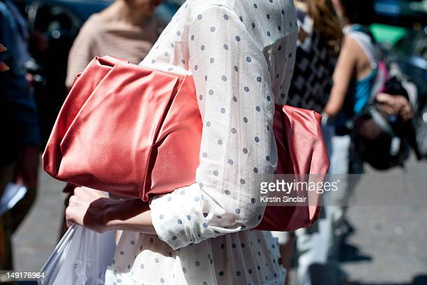 Ulyana Sergeenko fashion designer wearing a Prada bag and a dress from her own collection at Paris Fashion Week Autumn/Winter 2012 haute couture...