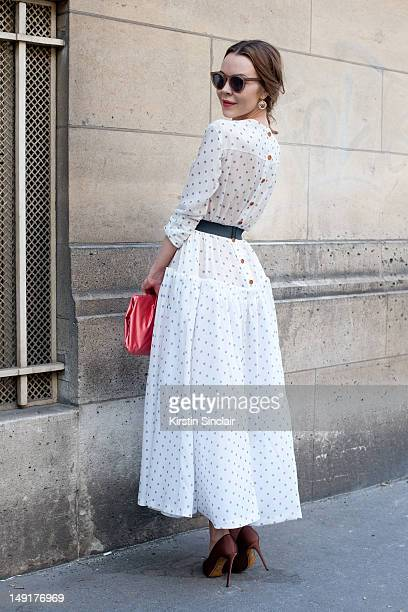 Ulyana Sergeenko fashion designer wearing a Prada bag Dolce and Gabbana shoes and a dress from her own collection at Paris Fashion Week Autumn/Winter...