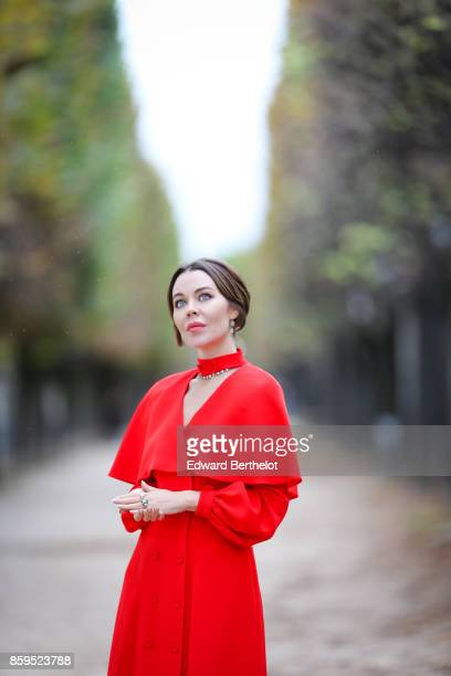 Ulyana Sergeenko is seen wearing a red dress at the Tuileries garden on October 7 2017 in Paris France