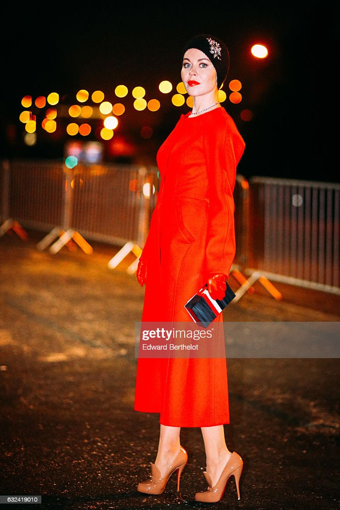 Ulyana Sergeenko is wearing a red dress, outside the Thom Browne show, during Paris Fashion Week Menswear Fall/Winter 2017/2018, on January 22, 2017 in Paris, France.