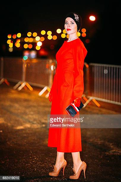 Ulyana Sergeenko is wearing a red dress outside the Thom Browne show during Paris Fashion Week Menswear Fall/Winter 2017/2018 on January 22 2017 in...