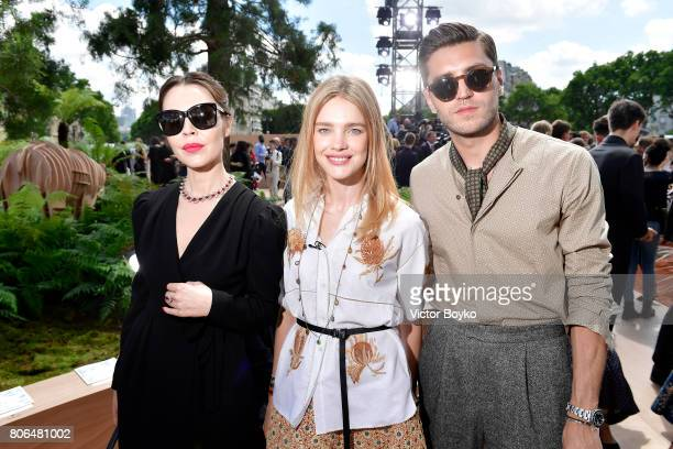 Ulyana SergeenkoNatalia Vodianova and a guest attend the Christian Dior Haute Couture Fall/Winter 20172018 show as part of Haute Couture Paris...