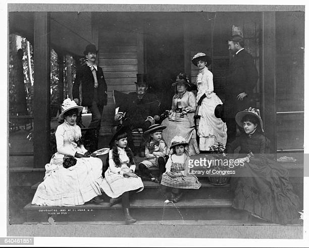 Ulysses S Grant sits on the porch with members of his family