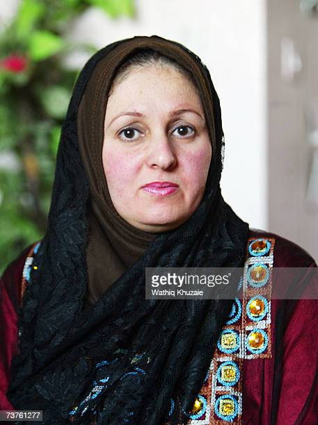 Um Ahmed wife of Fuad Mosa Muhammad looks on at her house on March 28 2007 in Baghdad Iraq Fuad a cook at a breakfast and lunch restaurant was...