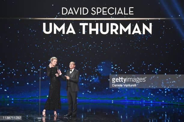 Uma Thurman and Carlo Conti attend the 64. David Di Donatello - Award Ceremony on March 27, 2019 in Rome, Italy.