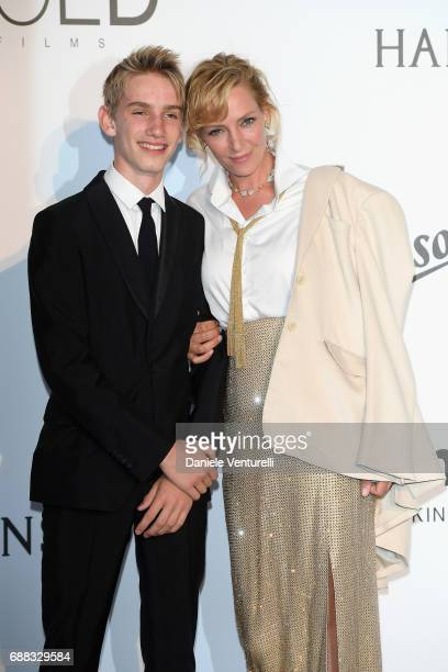 Uma Thurman and her son Levon Roan ThurmanHawke arrive at the amfAR Gala Cannes 2017 at Hotel du CapEdenRoc on May 25 2017 in Cap d'Antibes France