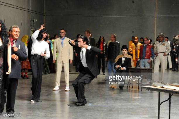 Uma Thurman and John Travolta act a scene from Pulp Fiction as Tom Hanks from Forrest Gump and Charlie Chaplin look on, The Hollywood Wax Museum...