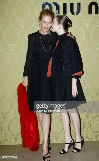 Uma Thurman and Maya Hawke attend the Miu Miu Resort Collection 2015 at Palais d'Iena on July 5 2014 in Paris France