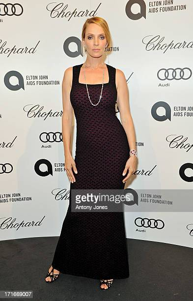 Uma Thurman attends the 15th Annual White Tie and Tiara Ball to Benefit Elton John AIDS Foundation in Association with Chopard at Woodside on June 27, 2013 in Windsor, England. No sales to online/digital media worldwide until the 14th of July. No sales before July 14th, 2013 in UK, Spain, Switzerland, Mexico, Dubai, Russia, Serbia, Bulgaria, Turkey, Argentina, Chile, Peru, Ecuador, Colombia, Venezuela, Puerto Rico, Dominican Republic, Greece, Canada, Thailand, Indonesia, Morocco, Malaysia, India, Pakistan, Nigeria. All pictures are for editorial use only and mention of 'Chopard' and 'The Elton John Aids Foundation' are compulsory. No sales ever to Ok, Now, Closer, Reveal, Heat, Look or Grazia magazines in the United Kingdom. No sales ever to any jewellers or watchmakers other than Chopard