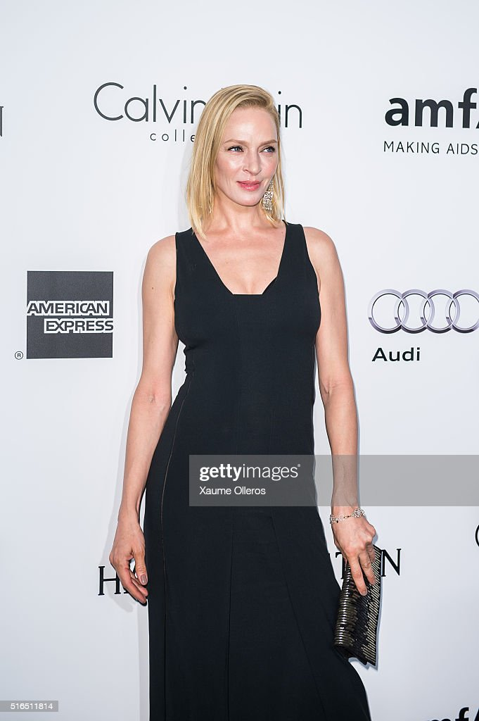 Uma Thurman attends the 2016 amfAR Hong Kong gala with a guest at Shaw Studios on March 19, 2016 in Hong Kong, Hong Kong.