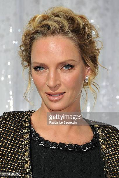 Uma Thurman attends the Chanel Ready to Wear Spring / Summer 2012 show during Paris Fashion Week at Grand Palais on October 4, 2011 in Paris, France.