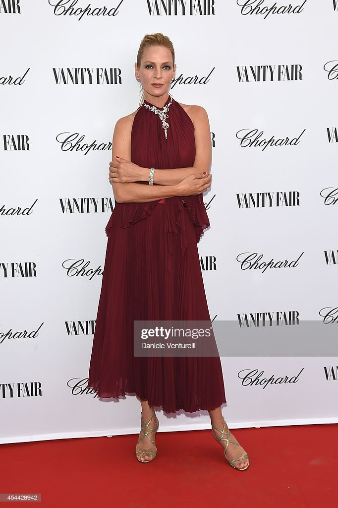 Uma Thurman attends the Chopard And Vanity Fair Present 'Backstage At Cinecitta' Exhibition - Red Carpet - 71st Venice Film Festival at Cipriani Hotel on August 31, 2014 in Venice, Italy.
